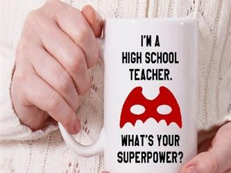 Person holding a mug that says Im a teacher. Whats your super power?